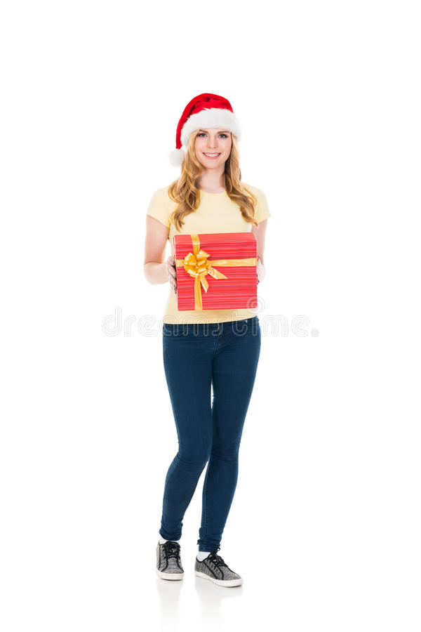 Happy teenage girl posing in a Christmas hat on white royalty free stock images