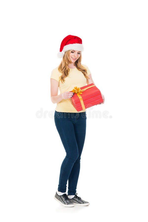 Happy teenage girl posing in a Christmas hat on white royalty free stock photos