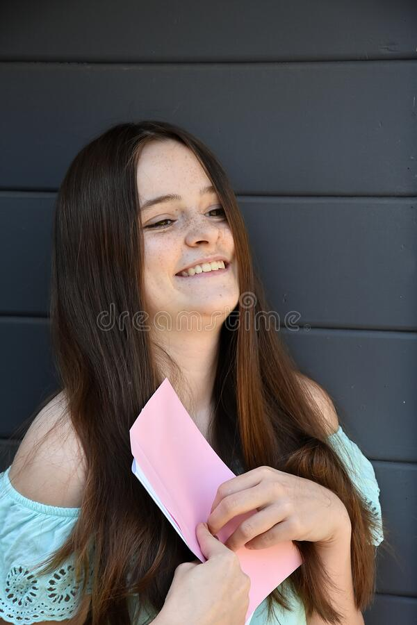 Free Happy Teenage Girl Received  A Love Letter Royalty Free Stock Photos - 216619918