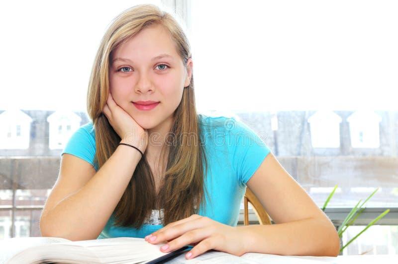 Happy teenage girl studying royalty free stock images