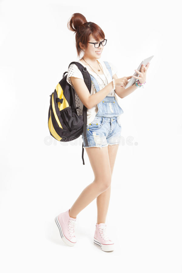 Happy teenage girl with tablet pc computer royalty free stock image