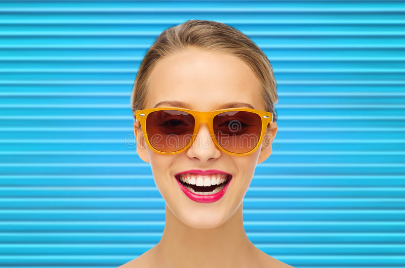 Happy teenage girl or woman face in shades royalty free stock photo
