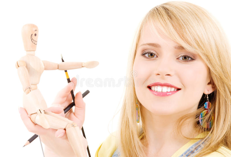 Happy Teenage Girl With Wooden Model Dummy Royalty Free Stock Image