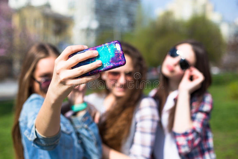 Happy teenage girls hawing fun spend time together in the city park stock image