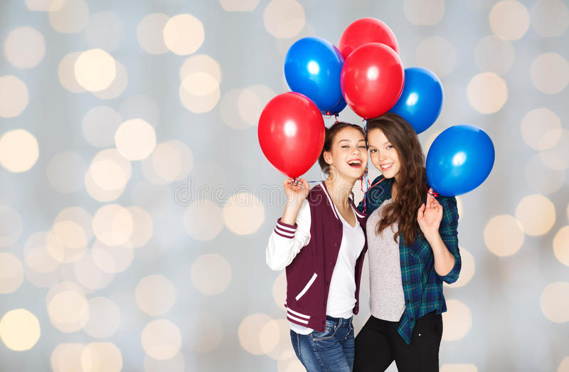 Happy teenage girls with helium balloons royalty free stock images
