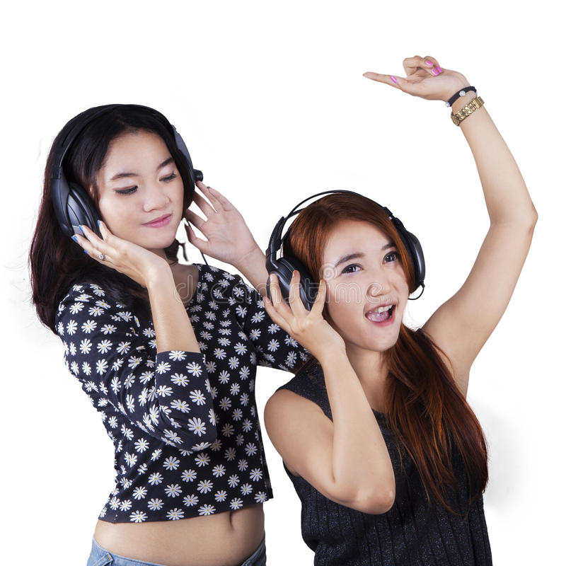 Happy teenage girls listening music royalty free stock photos