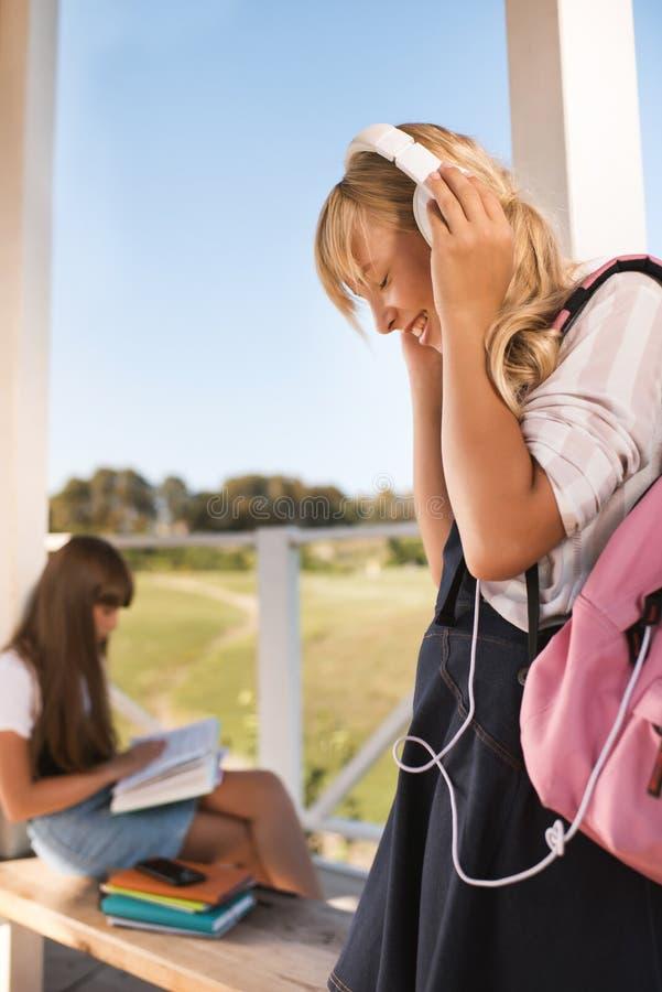 Happy teenage schoolgirls stock image
