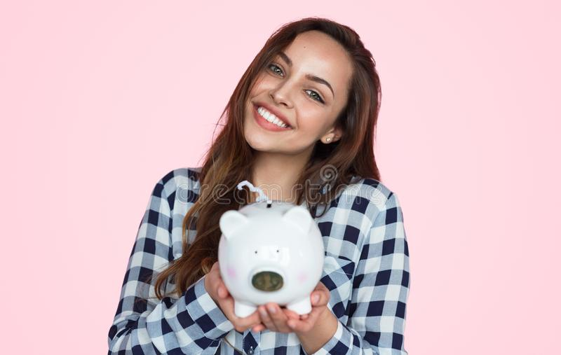Charming girl with piggy bank stock images