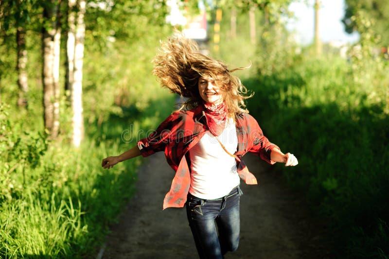 Happy teenager. Girl in red shirt walking stock image
