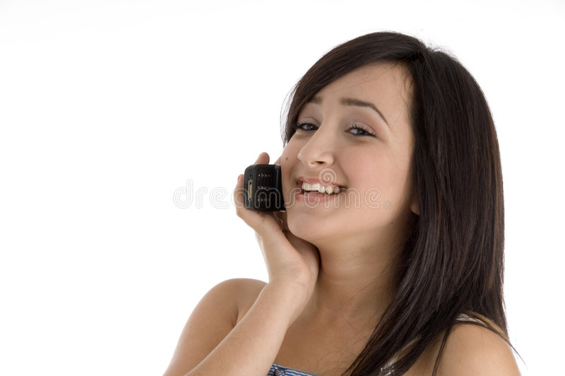 Happy teenager female. Happy teenager talking on mobile phone on an isolated white background royalty free stock photos