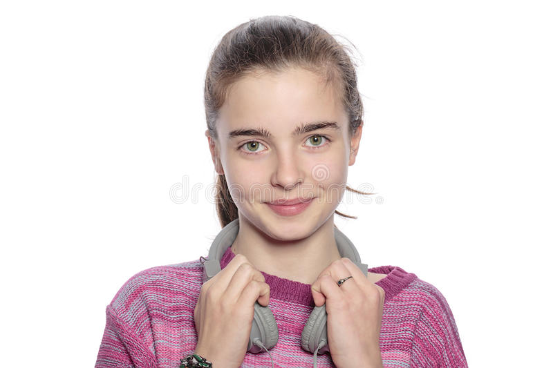 Happy teenager girl with headphones. Isolated on white stock photography