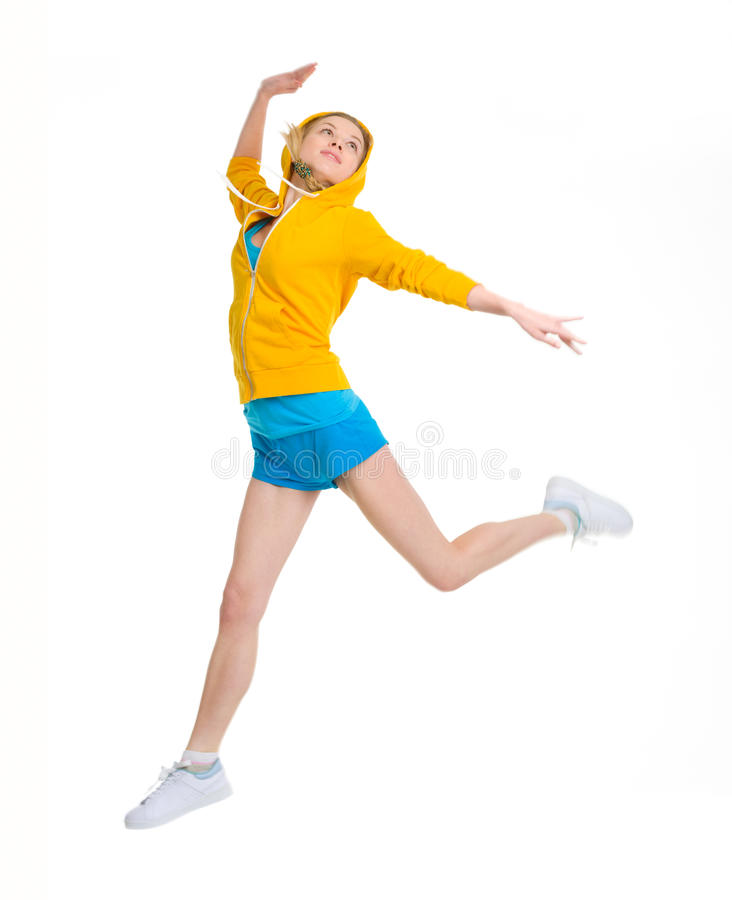 Happy teenager girl jumping stock photography