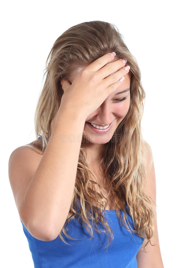 Happy teenager girl laughing with a hand in forehead. Isolated on a white background royalty free stock photography