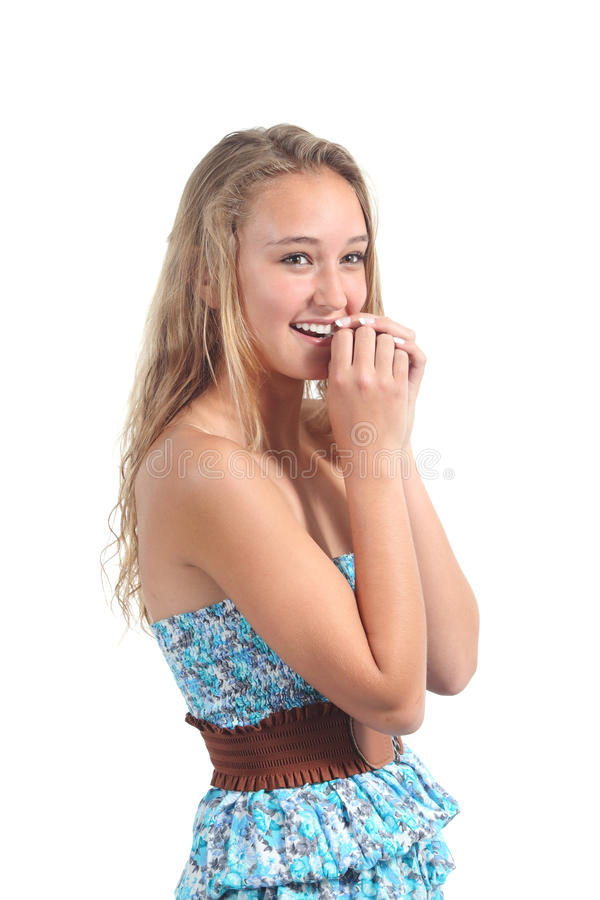 Happy teenager girl laughing timidly. With her hands together in the mouth isolated on a white background stock photo
