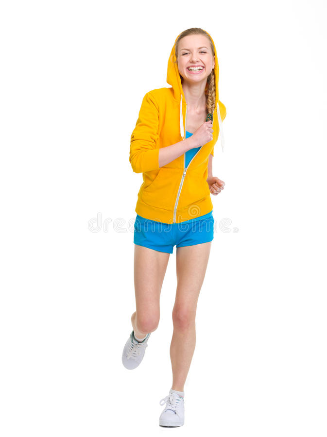 Happy teenager girl running. Isolated on white stock photos