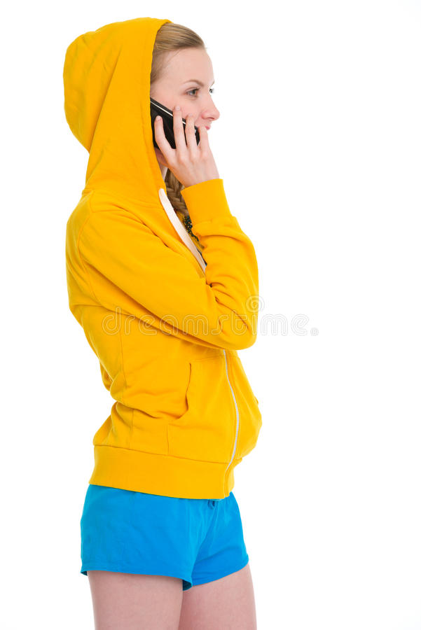Happy teenager girl talking cell phone. Isolated on white royalty free stock image