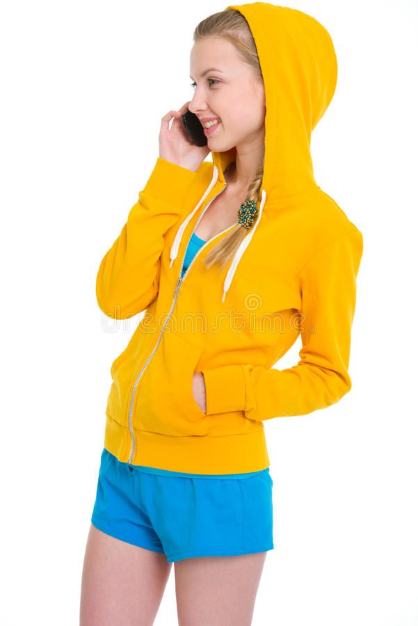 Happy teenager girl talking mobile phone. Isolated on white stock photo
