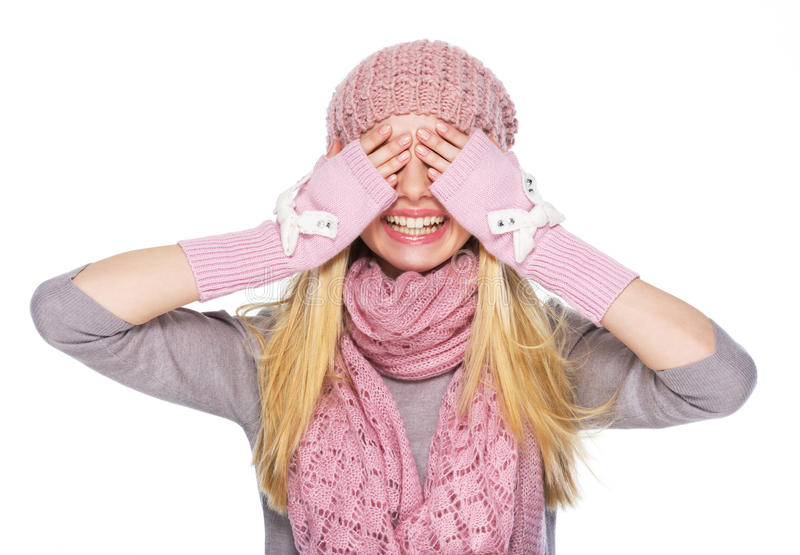 Happy teenager girl in winter hat and scarf closing eyes. High-resolution photo royalty free stock photo