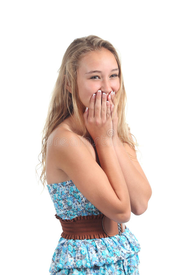 Happy teenager laughing timidity covering her mouth with the hands. Isolated on a white background royalty free stock images