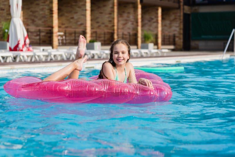 Teenage girl enjoy swimming pool stock image