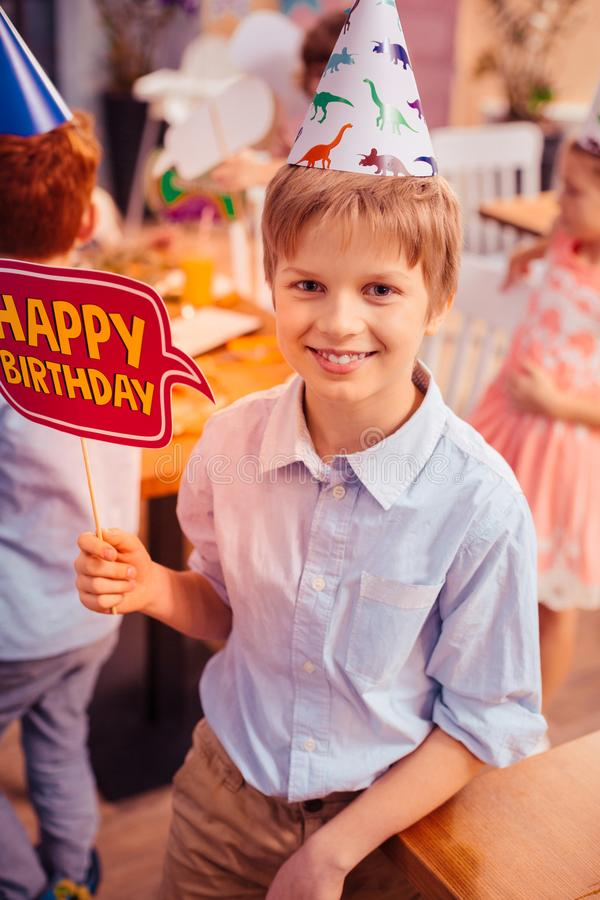 Happy teenager visiting birthday celebrating in class. My best friend. Cute male person expressing positivity while posing on camera royalty free stock image