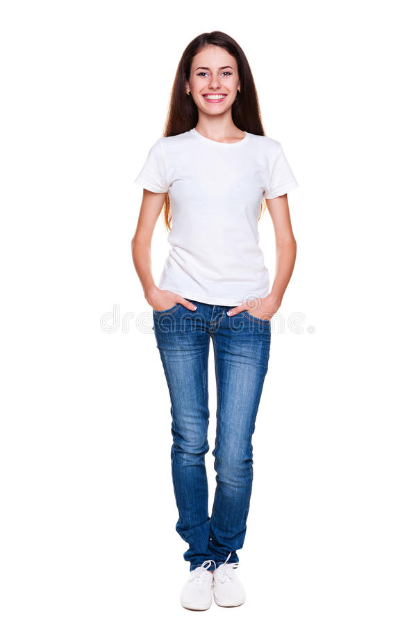 Happy teenager in white t-shirt and jeans. Portrait of happy teenager in white t-shirt and jeans. isolated on white background royalty free stock photos