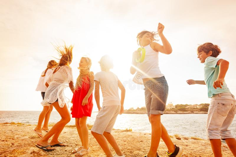 Happy teenagers having fun during beach party royalty free stock photography
