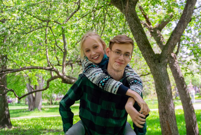 Happy teenagers in the park stock photo