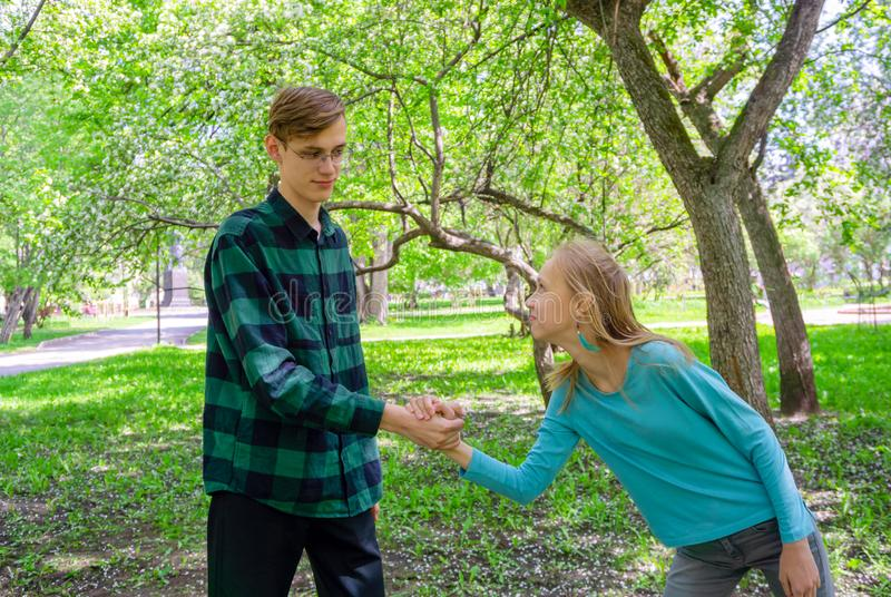 Happy teenagers in the park royalty free stock photo