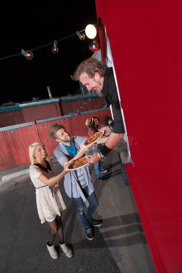 Teenagers Ordering Pizza from Food Truck stock photos