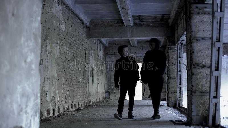Happy teenagers walking in abandoned house and laughing, procrastination. Stock photo royalty free stock image