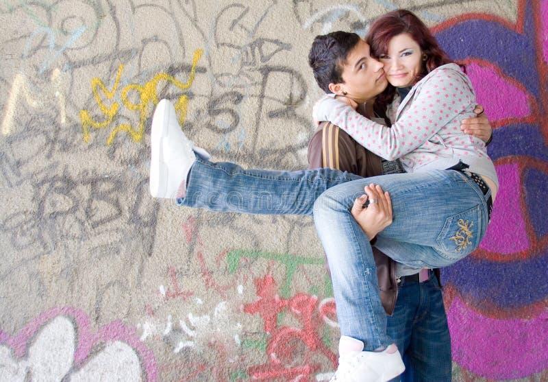 Happy teens. Couple boy holding girl royalty free stock photos