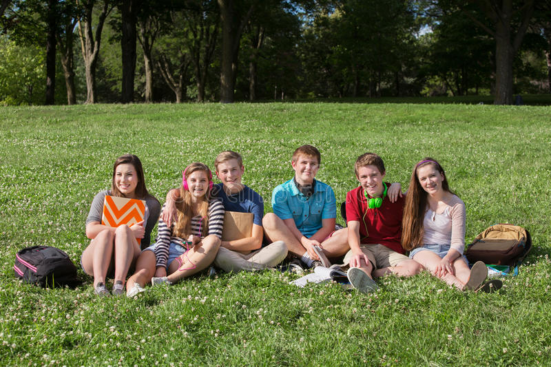 Happy Teens with Backpacks. Happy group of teens students with backpacks royalty free stock image