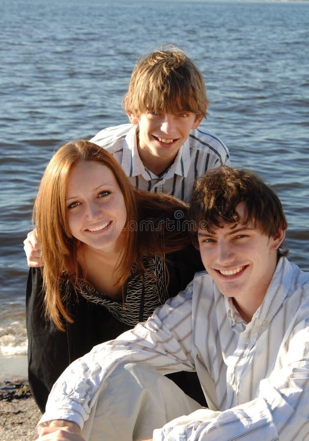 Happy teens at beach stock photo