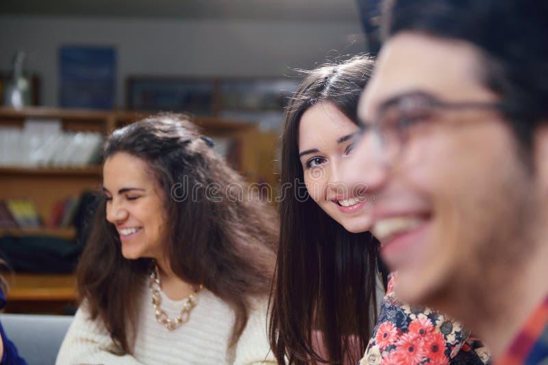 Happy teens group in school stock photos