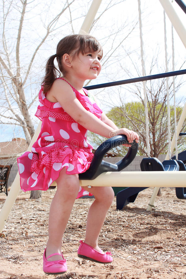 Happy Teeter-Totter Girl Royalty Free Stock Photos