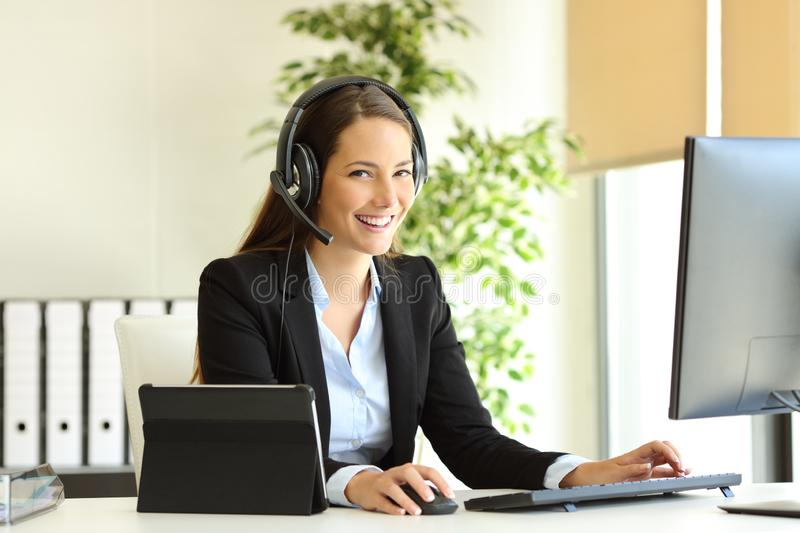Happy tele marketer working looking at camera at office royalty free stock images