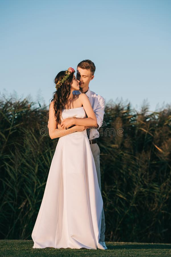 happy tender young wedding couple embracing and smiling royalty free stock images