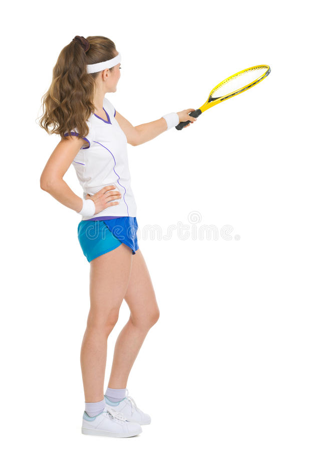 Happy tennis player pointing with racket. Full length portrait of happy tennis player pointing with racket on copy space royalty free stock photos