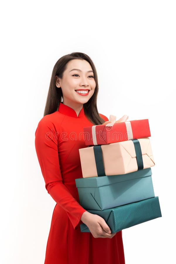 Happy Tet holiday chinese new year. Smile asian woman in ao dai holding new year gift box present.  stock image