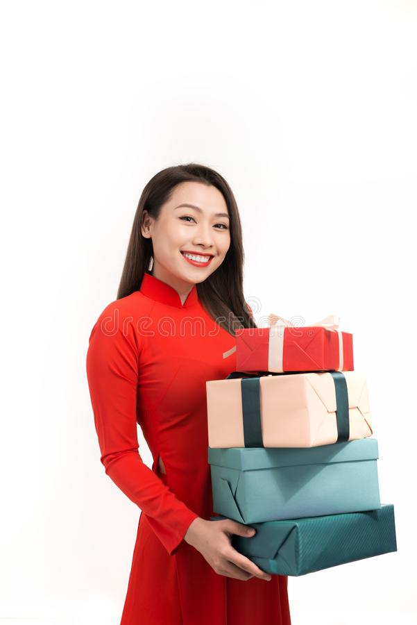 Happy Tet holiday chinese new year. Smile asian woman in ao dai holding new year gift box present stock image