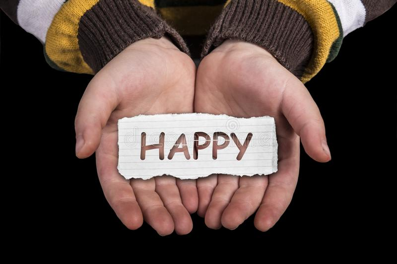 Happy text on hand. Happy text in line paper on child hand , isolated on black background stock photography