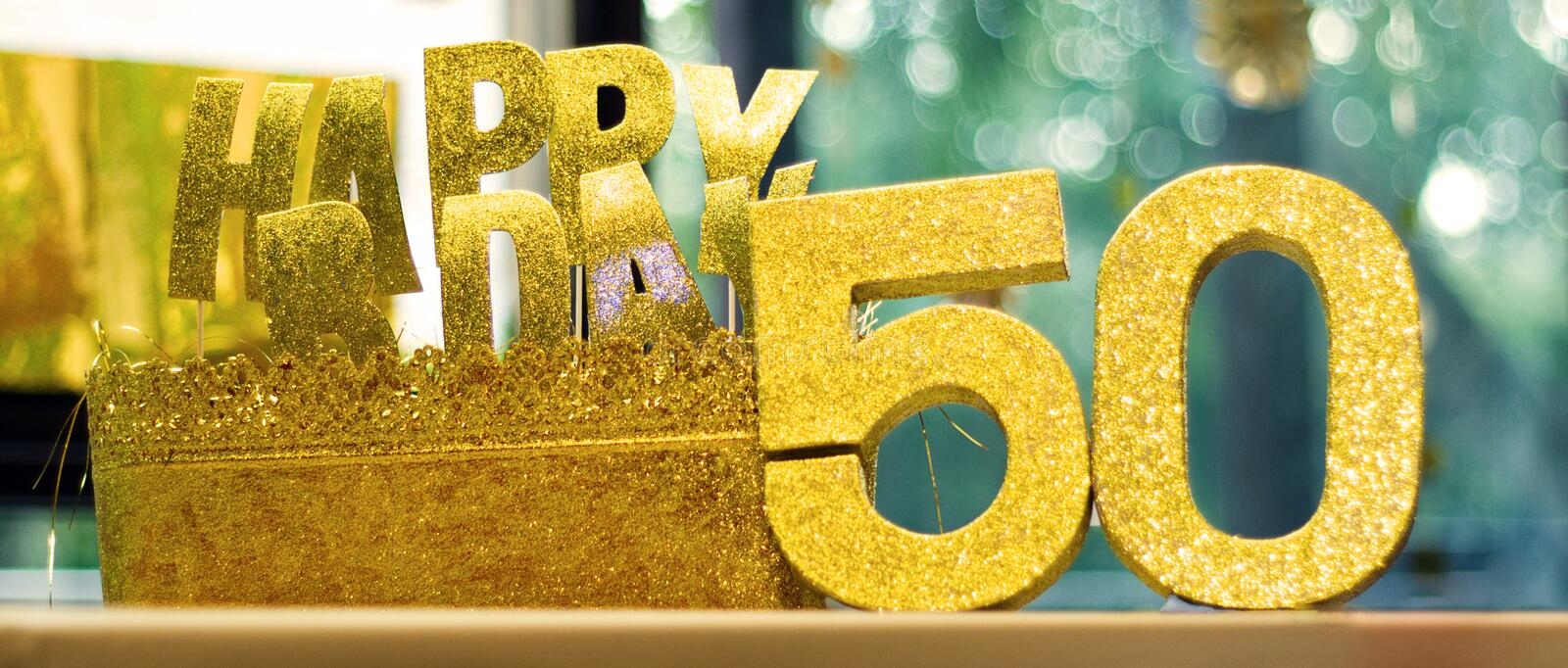Happy 50th Birthday glittering props on a table royalty free stock image