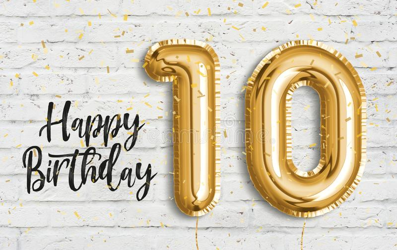 Happy 10th birthday gold foil balloon greeting white wall background. royalty free illustration