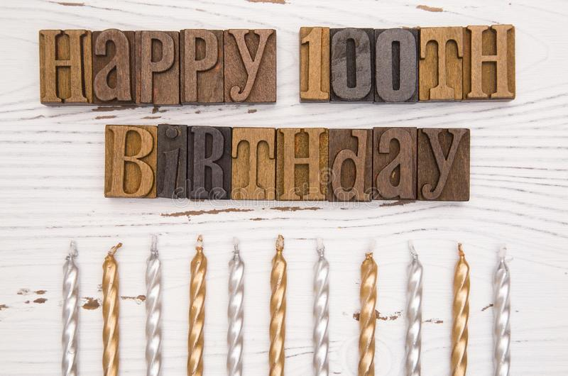 Happy 100th Birthday Spelled in Type Set royalty free stock photography