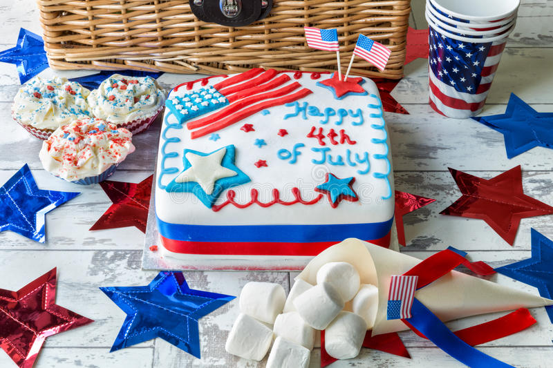 Happy 4th of July cake with hamper. Cupcakes and marshmallows stock photography