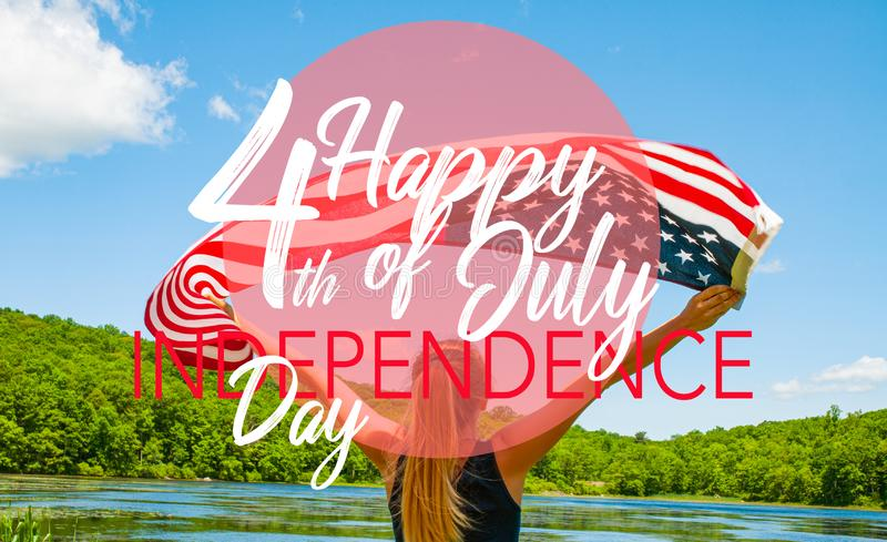 Happy 4th of July, Independence Day. Woman holding American flag. Happy 4th of July, Independence Day. Young woman holding American flag on lake background stock images