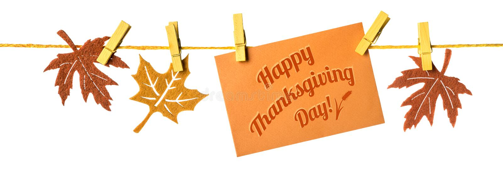Happy Thanksgiving! Autumn decorations and greeting card on a rope stock photo