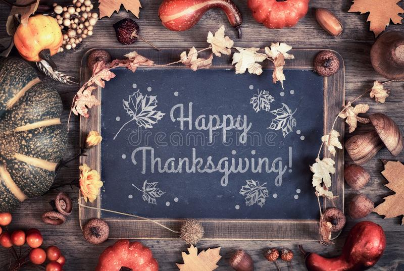 Happy Thanksgiving card design with blackboard and Fall decorati royalty free stock images