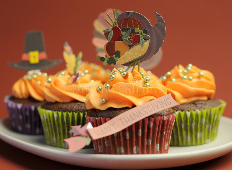 Happy Thanksgiving cupcakes with turkey, feast, and pilgrim hat topper decorations - closeup. royalty free stock photo